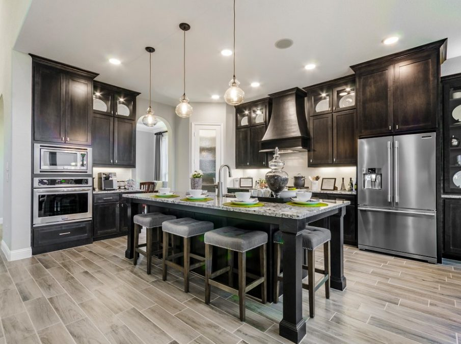 Landon Homes new home builder 432 Carrington Kitchen brown stained cabinets and long kitchen island