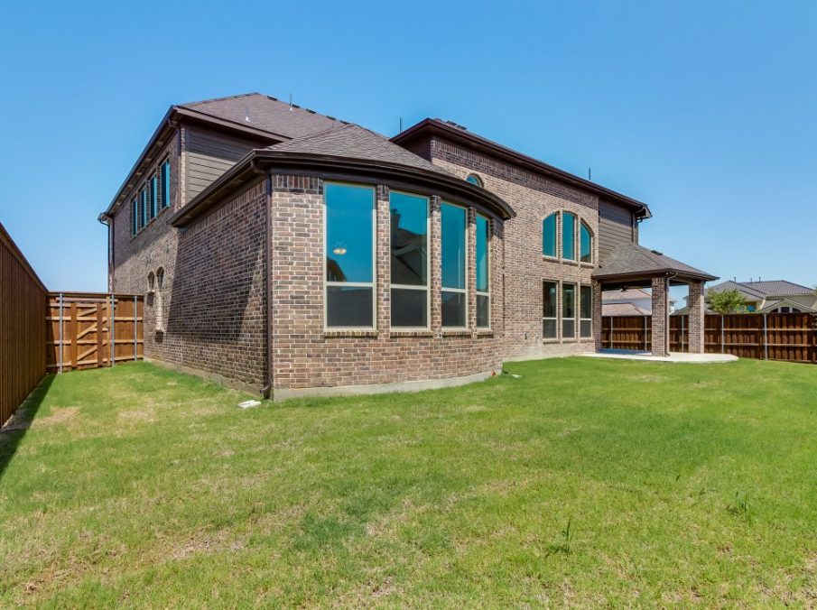 Landon Homes New Home Builder 798 Montblanc Stone and Brick Exterior Backyard View