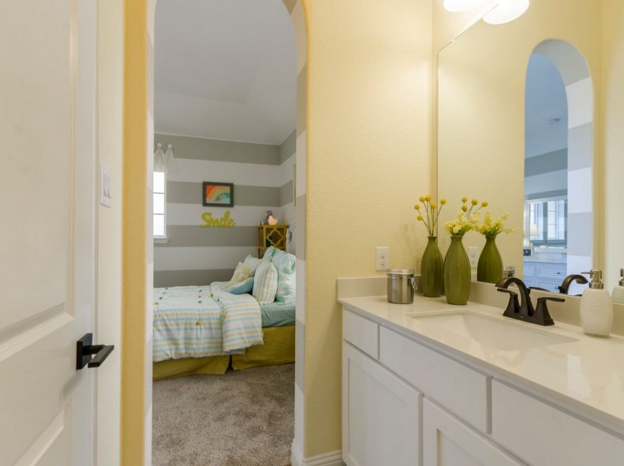 Landon Homes new home builder 432 Carrington Kids Bathroom with yellow walls and white painted cabinets