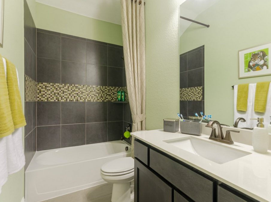 Landon Homes new home builder 432 Carrington Bathroom with green walls and grey shower tiling