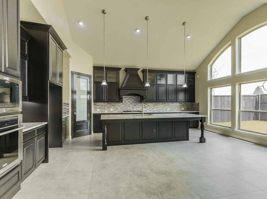 795 Landonshire Landon Homes Kitchen Island with Pendant Lights and Black Painted Cabinets