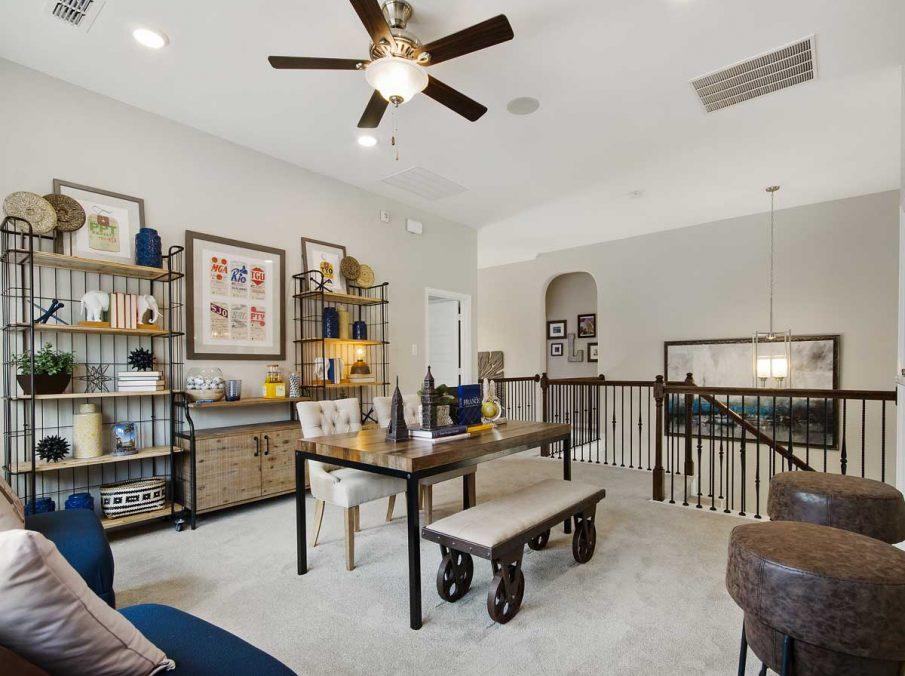 4655 Wellington Landon Homes Decorated Gameroom with Carpet