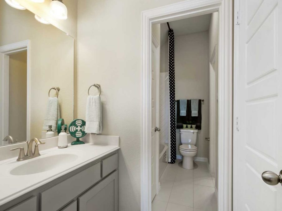 4655 Wellington Landon Homes Decorated Bathroom with light Grey painted Cabinets and White Counter-tops