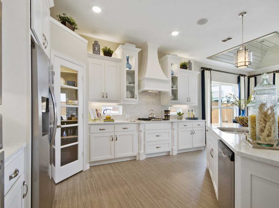 4655 Wellington Landon Homes Decorated Kitchen White Painted Cabinets and Recessed Lighting