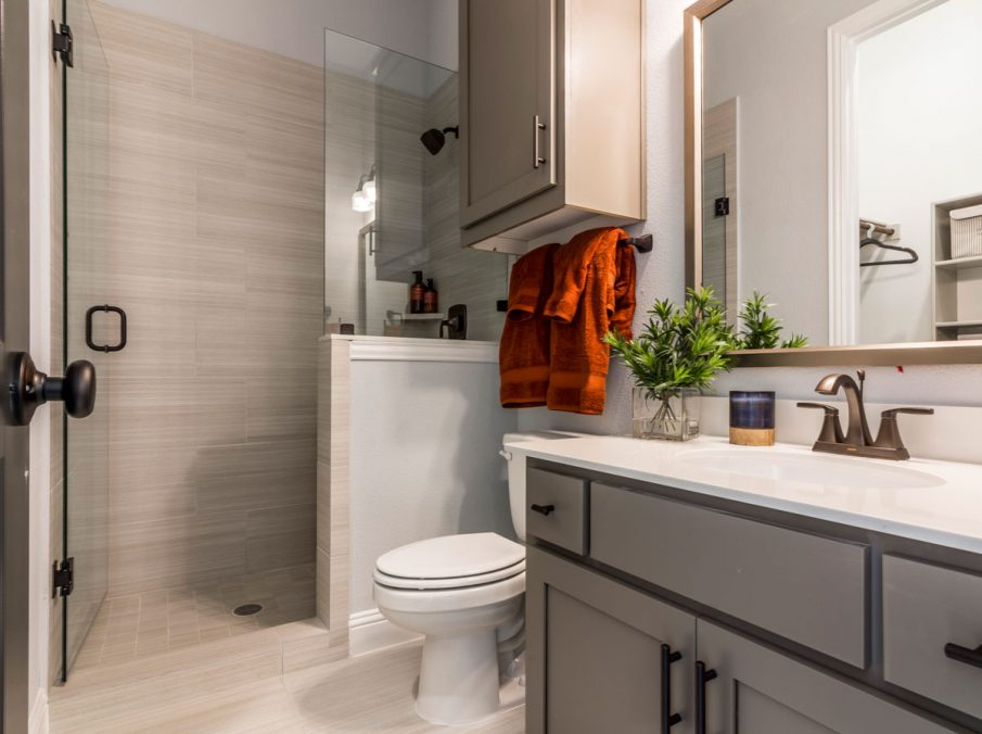 Landon Homes 675 Newbridge Guest Bathroom Shower with Tan Tile