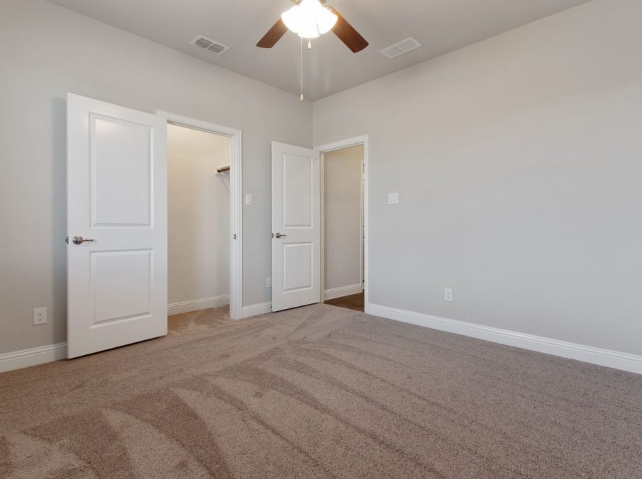 Landon Homes new home builder 515 Sherwood bedroom with light carpet