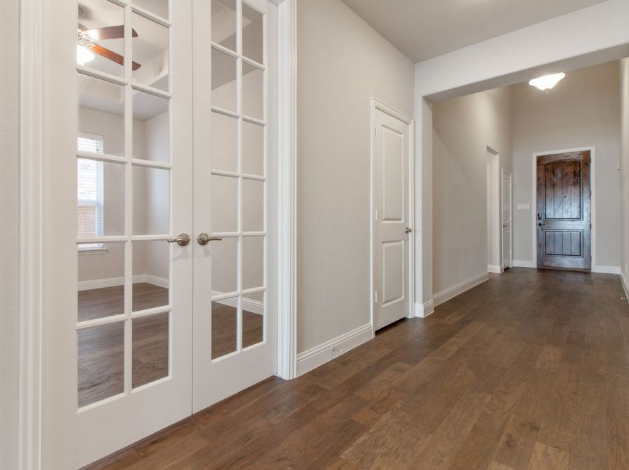 Landon Homes new home builder 515 Sherwood Hallway with white walls and wooden floors