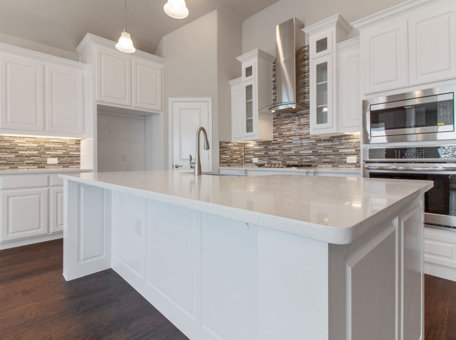 Landon Homes new home builder 515 Sherwood kitchen island and stainless steel appliances white cabinets