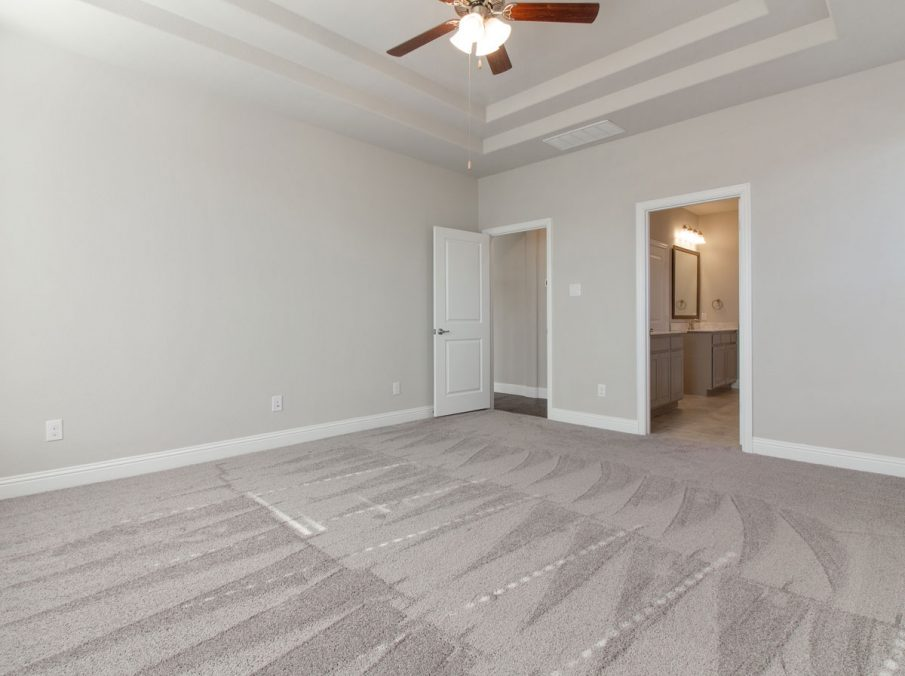 Landon Homes new home builder 515 Sherwood master suite with light tan carpets