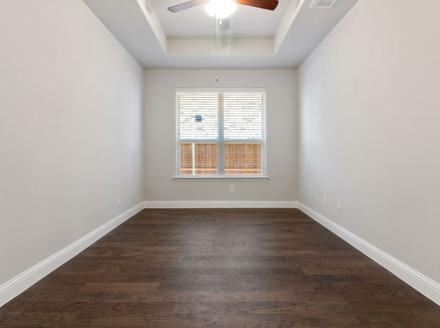 Landon Homes new home builder 515 Sherwood Study with white walls and wooden floors