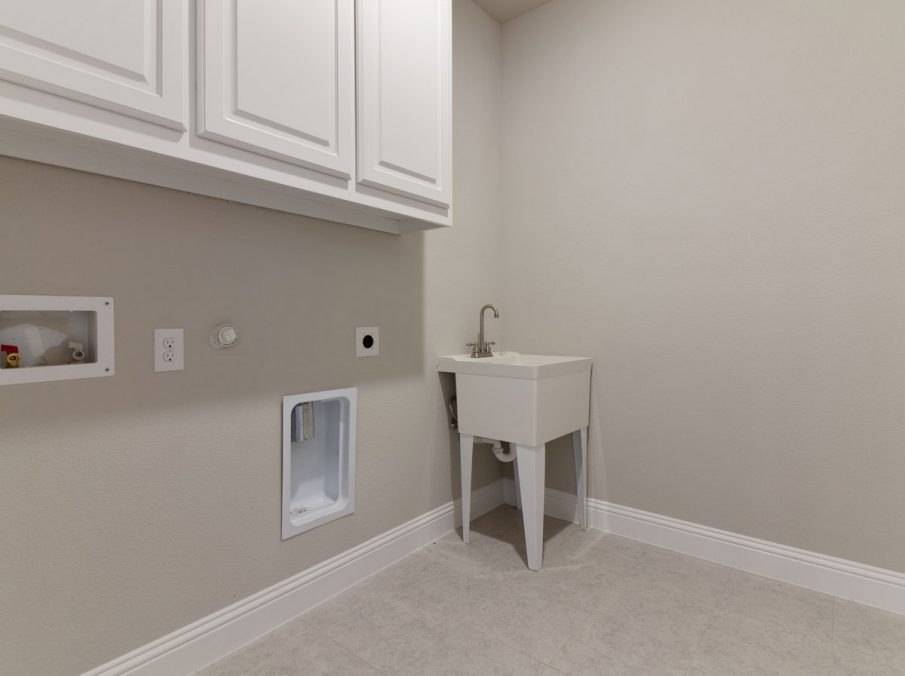 Landon Homes new home builder 515 Sherwood utility room with white cabinets
